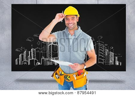 Portrait of smiling manual worker holding clipboard against composite image of black card