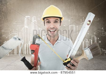 Portrait of happy worker holding various equipment against hand drawn city plan