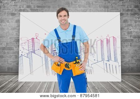 Confident carpenter with hands on hip against composite image of white card