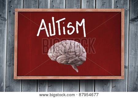 brain against blackboard with copy space on wooden board