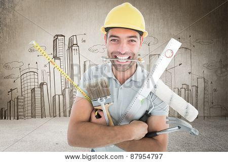 Portrait of smiling handyman holding various tools against hand drawn city plan