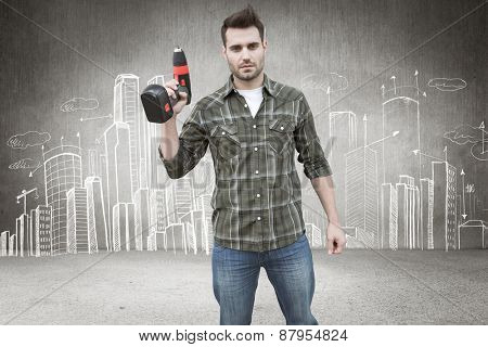 Worker holding drill against hand drawn city plan
