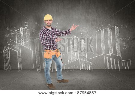 Handyman showing something against hand drawn city plan