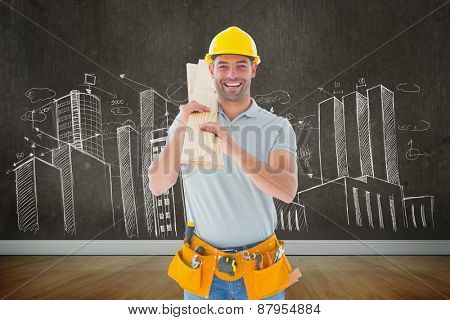 Carpenter against room with wooden floor