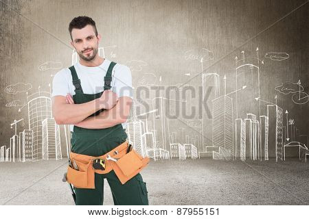 Carpenter smiling at camera against hand drawn city plan
