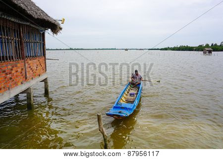 Vietnamese Man Sails A Boat Over The Mekong River