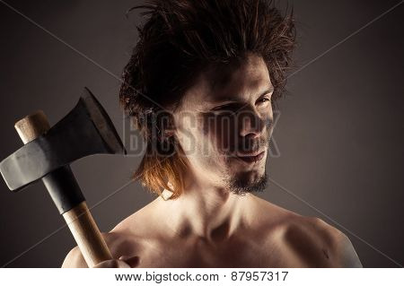 portrait man with an ax in hand