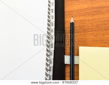 Planner Diary With Pencil And Paper Note