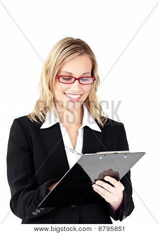 Serious Businesswoman Wearing Glasses Taking Notes In Her Clipboard