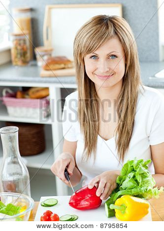 Close-up Of A Woman Cutting Paprika In The Kitchen