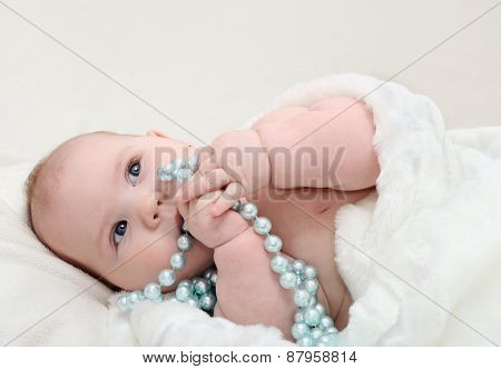 Adorable Little Baby With Beads Looking Aside
