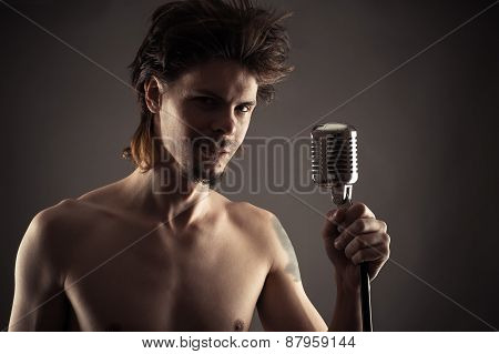 young singer with retro microphone