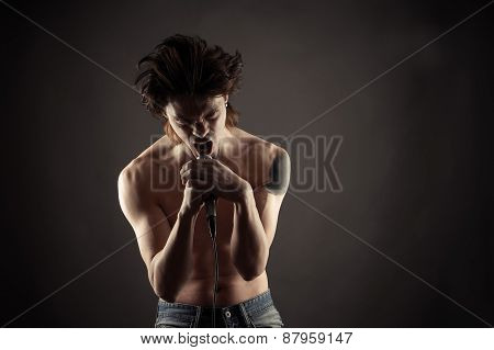 brutal rock singer singing into a microphone