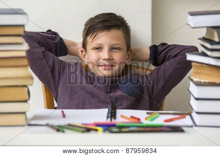 Schoolboy resting during homework time.