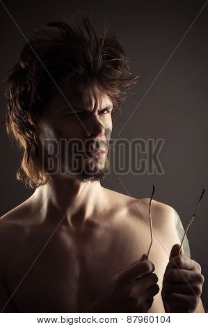 man with two burnt wires