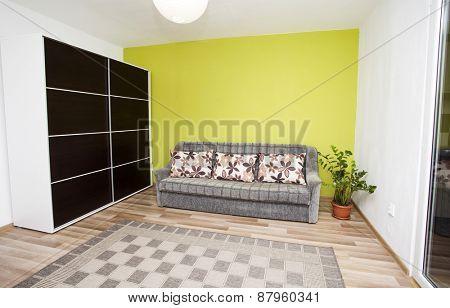 Green interior of a living room