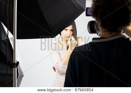 Gorgeous Female Model Posing In Front Of Camera For Commercial