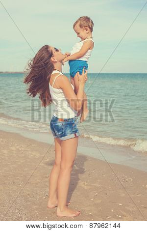 Happy Mother And Son Enjoying Beach Time