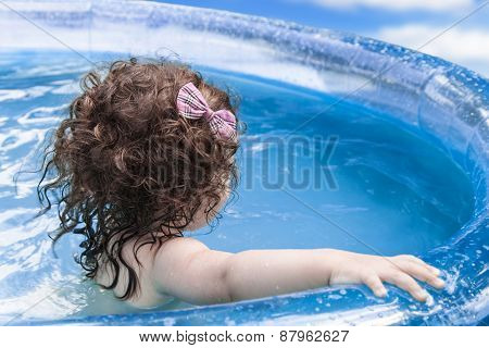 Girl Swims In Inflatable Pool