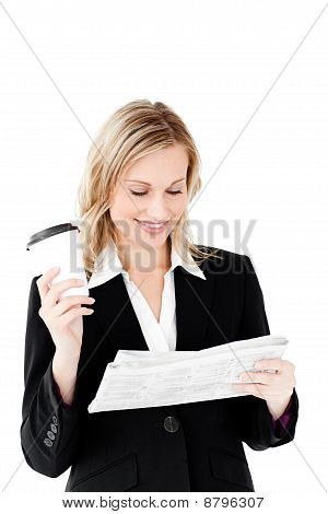 Beautiful Businesswoman Holding A Cup Of Coffee Reading A Newspaper