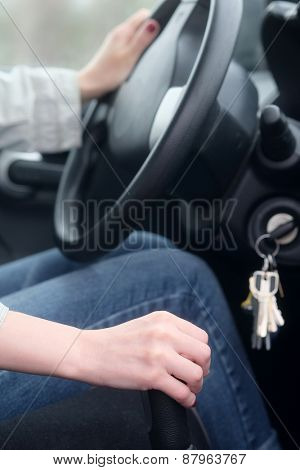 Woman manually shifting the car transmission