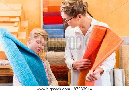 Family Designer buying rug or carpeting in home improvement store
