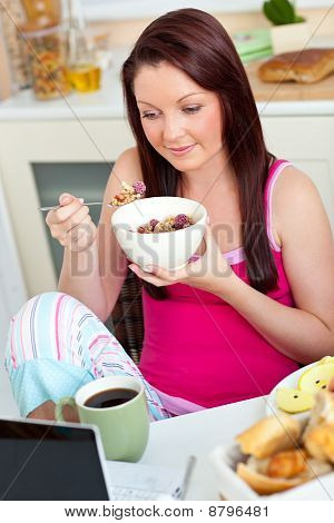 Beautiful Caucasian Woman Having Breakfast Smiling At The Camera Sitting In The Kitchen