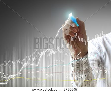 businessman hand writing a business graph
