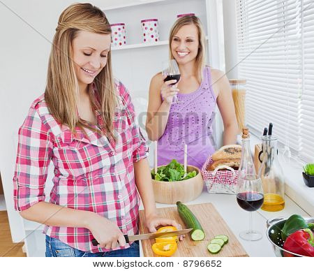 Two Positive Women Cooking Together At Home