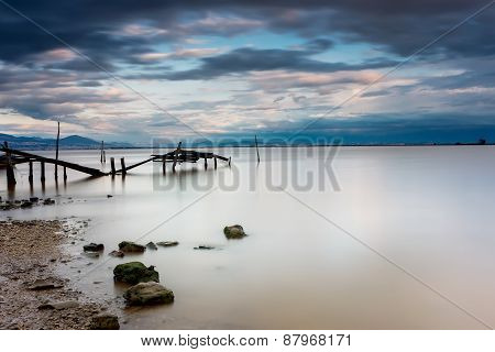 Long Exposure Of Magic Sunrise And Wooden Pier. Photographed Using Nd Filter
