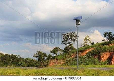 Electric Pole With Solar Panel On Road In Countryside, Use Of Solar Energy For Lightning, Brazil