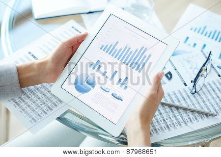 Business data in touchpad held by female