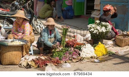 Flower Vendor Sets Up Her Stall