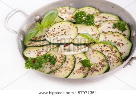 pan with courgette and herbs