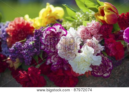 bouquets of flowers at the monument
