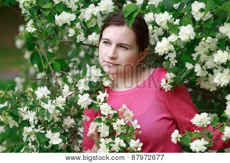 Woman Surrounded By Flowers