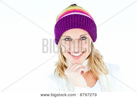 Merry Woman With A Colorful Hat Smiling At The Camera