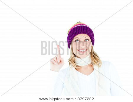 Young Caucasian Woman Wearing A Colorful Hat Pointing Upwards With Her Finger
