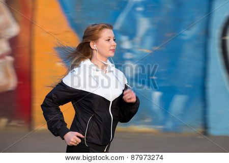 Runner Girl On Jogging Practice Beside bright Wall