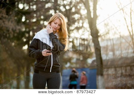 Runner Girl With Smartphone Before Morning Jogging