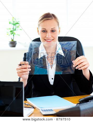 Confident Businesswoman Preparing Slides For A Presentation In Her Office
