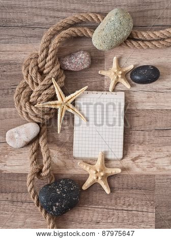 paper, rope, starfish, sea stones