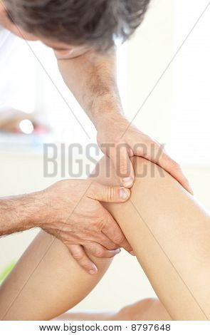 Close-up Of A Young Physical Therapist Giving A Leg Massage