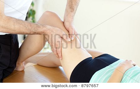 Caucasian Young Physical Therapist Giving A Leg Massage