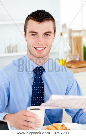 Happy Businessman Reading The Newspaper Drinking Coffee In The Morning At Home