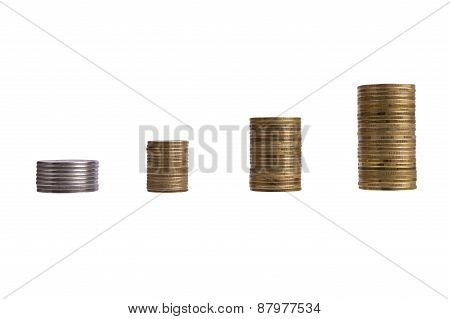 Growing Piles Of Coins Isolated Over White