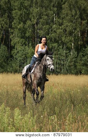 Beautiful Woman Riding Gray Horse In The Forest
