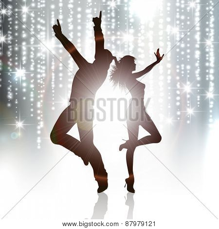 Silhouettes of people dancing on a sparkle background