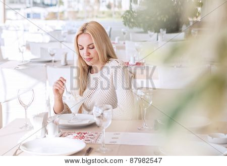 Beutiful Young Woman In Cafe on Sunny Day
