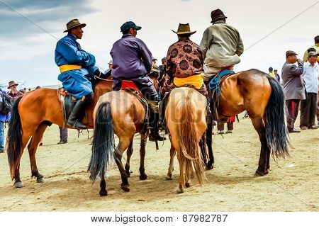 Horseback Spectators In Traditional Deel, Nadaam Horse Race, Mongolia